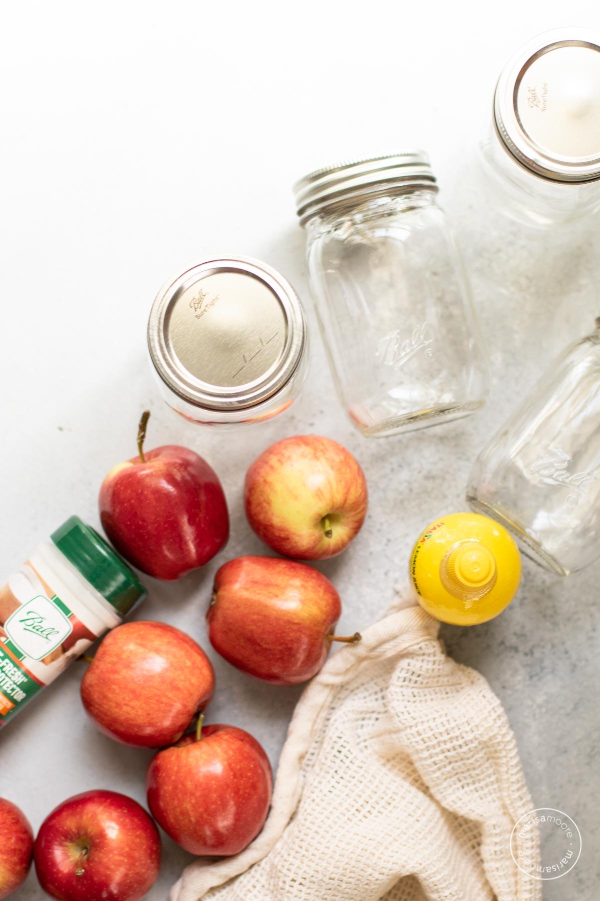 Ingredients for the recipe: apples, bottled lemon juice, fruit protector, empty pint jars