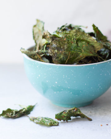 Kale chips in a blue bowl
